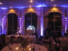 Purple uplighting & Cake Spotlighting at a Bahia Resort San Diego wedding