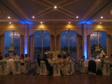 Sweetheart Table With Blue Uplighting at  Bahia wedding in San Diego