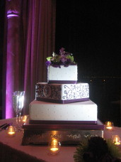 Purple uplighting & Cake Spotlighting Close at a Bahia Resort San Diego wedding